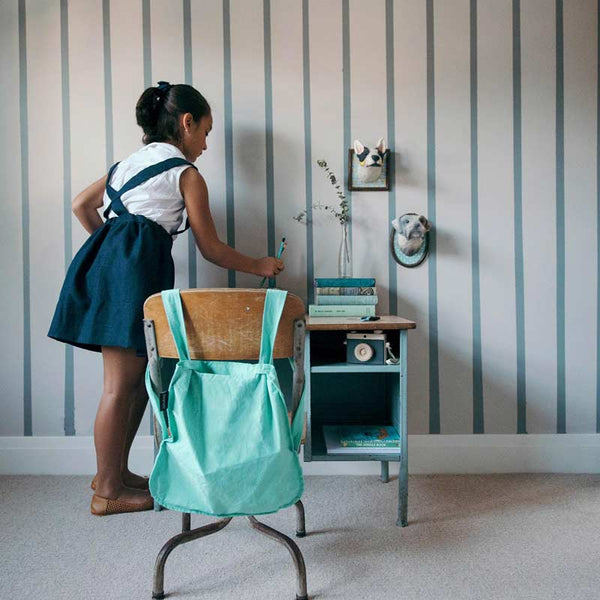 Notabag mini 2 in one tote and backpack in mint shown in childs bedroom