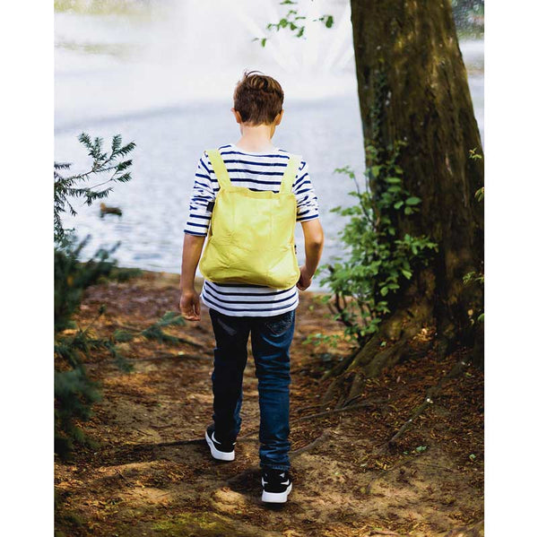 Notabag mini 2 in one tote and backpack in Yellow shown as backpack on a young boy