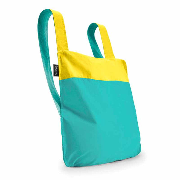 Notabag Yellow & Mint 2 in 1 back and backpack shown as backpack