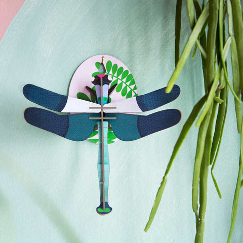 Studio Roof Blue Dragonfly Wall Decoration shown on blue wall