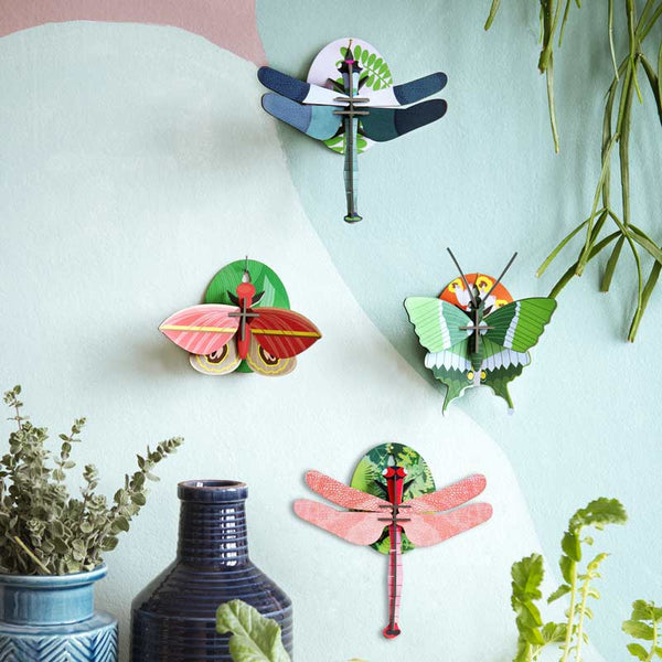 Studio Roof Pink Dragonfly Wall Decoration shown with other insect wall decorations