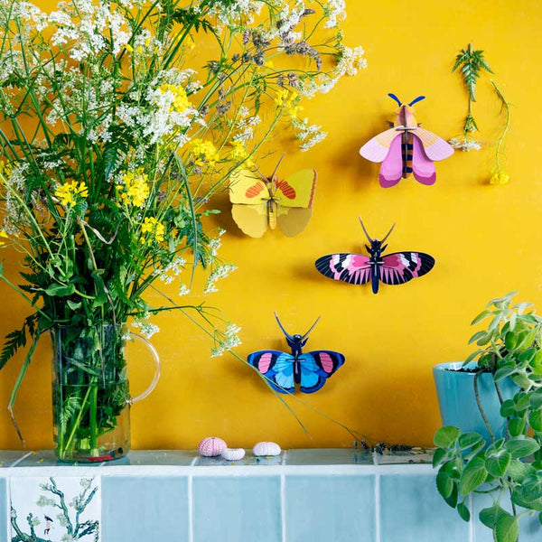 Studio Roof Yellow Butterfly Wall Decoration shown with other insect wall decorations