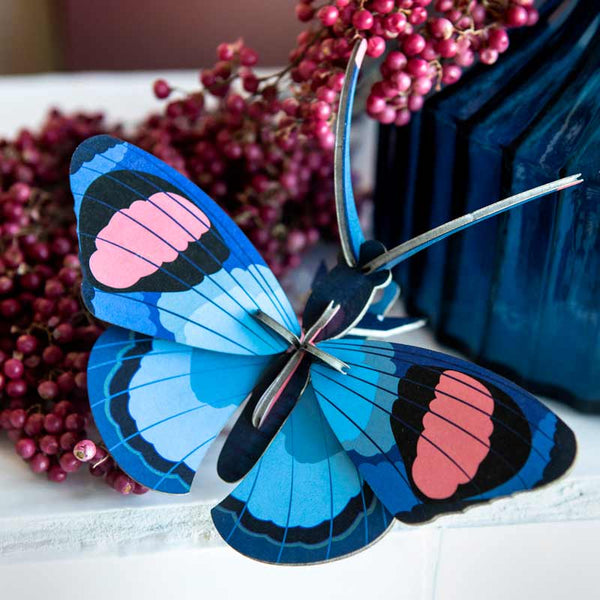 Studio Roof Peacock Butterfly Wall Decoration shown on table