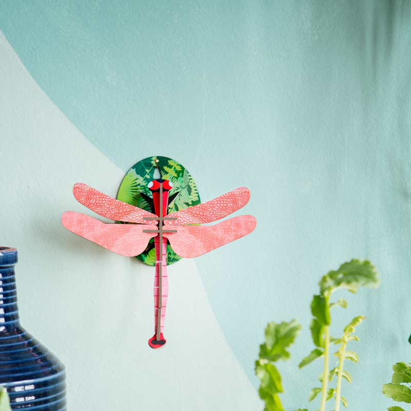Studio Roof Pink Dragonfly Wall Decoration shown on green wall