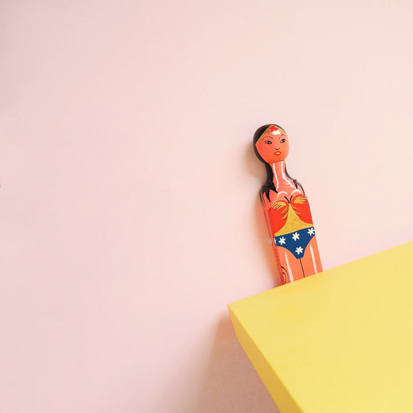 Handpainted wooden doorstop painted as wonder woman