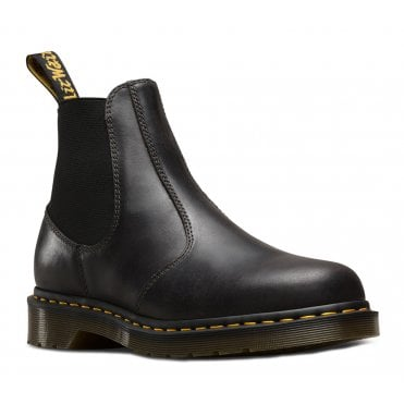 Product description Department:  Gentlemen , ladies Category:  Boots & Boots Colour:  black Fit:  Large Upper:  leather Lining:  leather Sole:  rubber Heel height:  3,5 cm Boot Length:  14 cm Boots size:  26 cm Brand:  Dr. Martens Item number:  03990-00 Dr Martens 2976 Chelsea Black The brand Dr Martens is known worldwide for its boots. The sturdy, beautiful boots are available in many forms and were originally intended to enhance the army boots of the company's founder, Klaus Märten. Today, the boots are known for their high quality and are often associated with the working class and punk. The model Dr Martens 2976 Chelsea Black differs a bit from the classic boot model. The characteristic, long lacing is lacking in these boots and is instead replaced by a stylish Chelsea model with elastic inserts on the sides. This makes it easy to put on and take off the shoes. Although the Dr Martens 2976 Chelsea Black shoe model does not have the traditional look of Dr Martens boots, they still have the same high quality and construction. The shoes have a rounded toe cap and the classic loop on the heel. Durability and construction of the highest quality Dr Martens are known for making leather shoes that feel a little stiff and stiff at the beginning. It takes a while for the leather to adapt to the feet. The leather provides a really elegant and polished surface. The sole is made of rubber and lined with the help of the Goodyear technique. The shoes are first sealed with heat and then seamed. This gives the shoes a unique durability while being breathable. Beautiful shoes that fit the most different styles