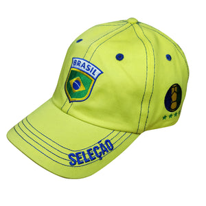Gold cap with embroidered Brasil insignia, bill reads Seleção, side features a football in colors of Brazilian flag