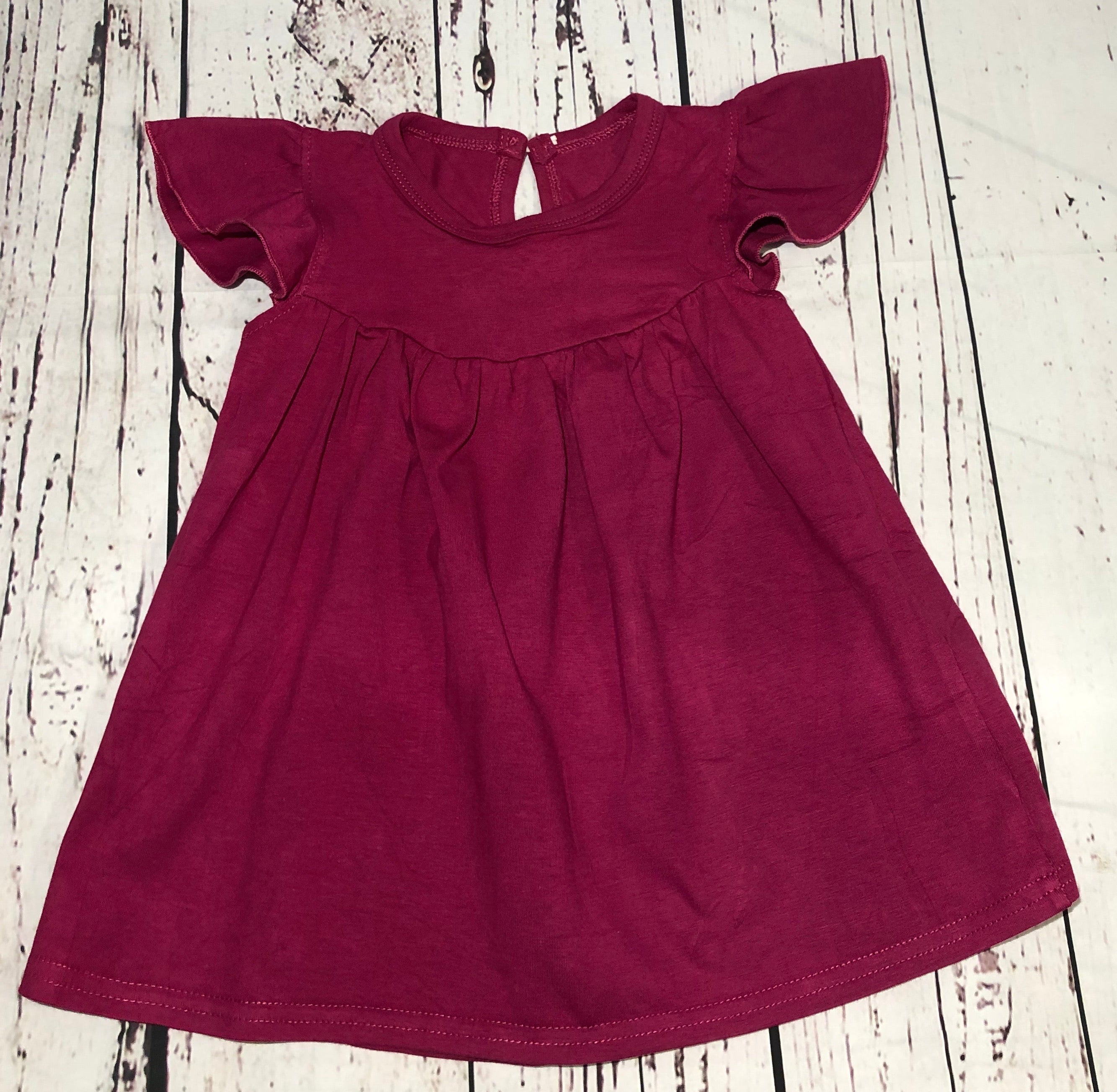 Plum Button Back Pearl Tunic