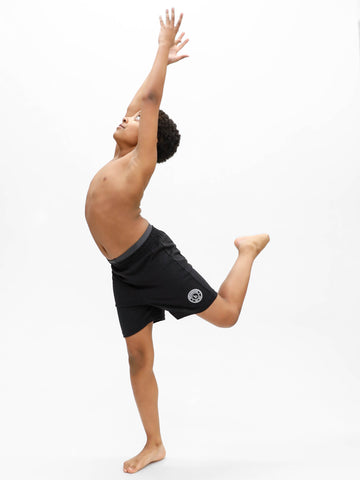 Devin Trey Campbell from ABC's Single Parents and Broadway's Kinky Boots wearing boys dance shorts for boysdancetoo the dance store for men