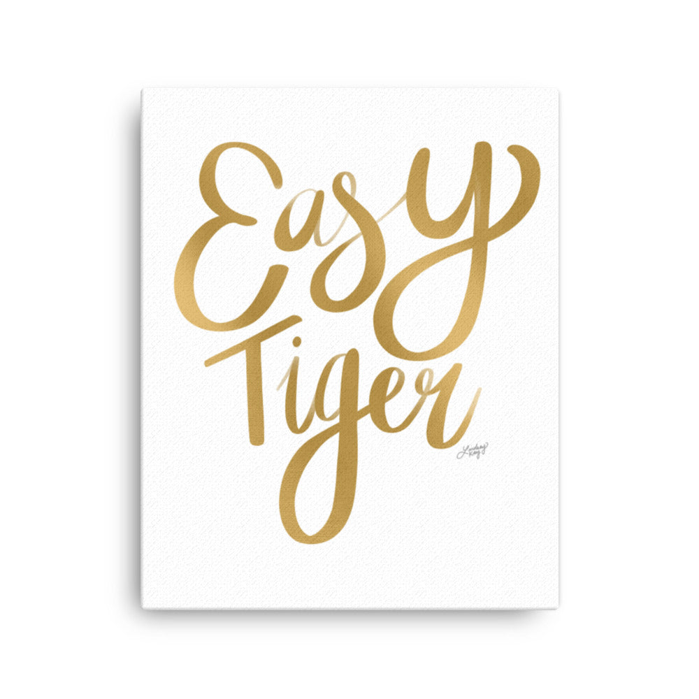 hand-lettered gold canvas that says Easy Tiger design by lindsey kay collective