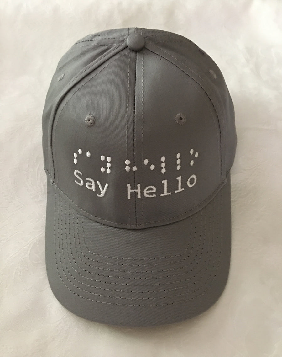 Deep Grey Baseball Cap with raised embroidery say hello logo in words and braille.