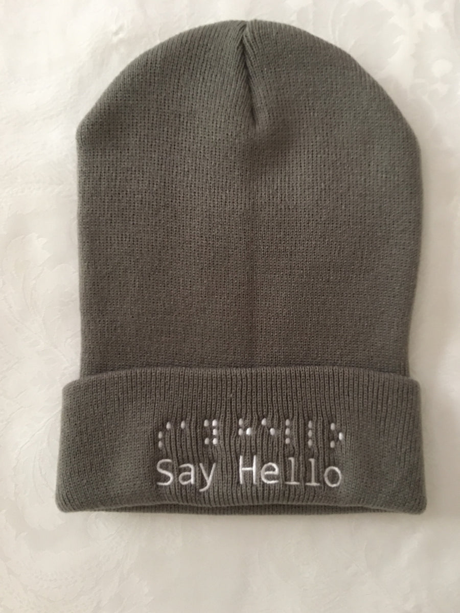 Dark Grey toque with white embroidery say hello logo in letters and braille.