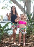 Matching sisters in floral beach vacation outfit