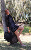 Woman in black crochet kaftan dress