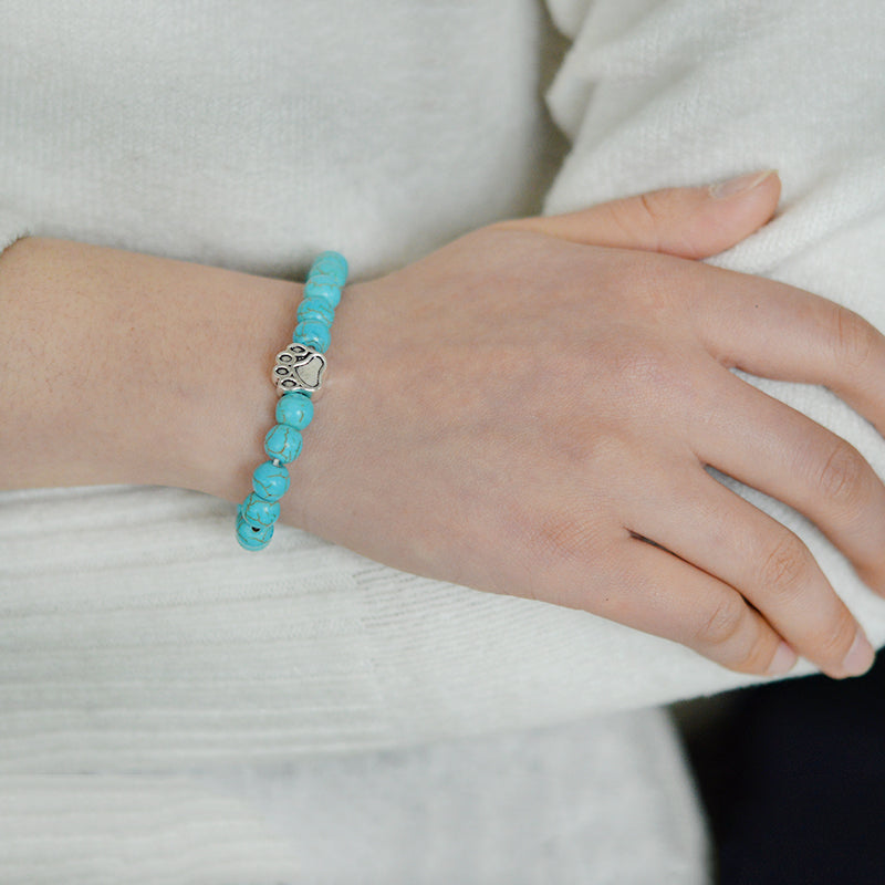 lady's hand showing her wearing a turquoise chakra bracelet