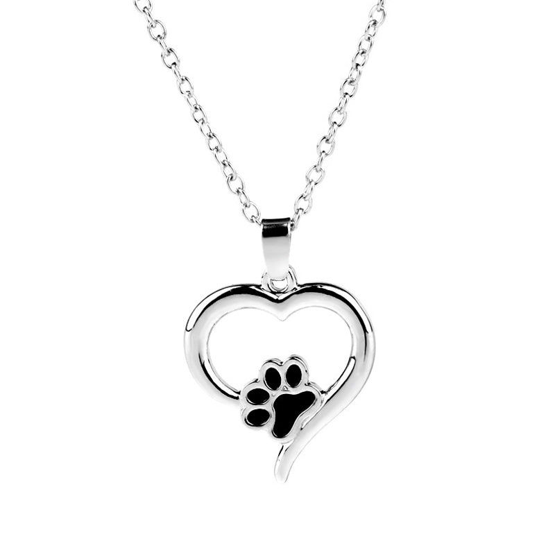 Heart shaped pendant with paw print on white background