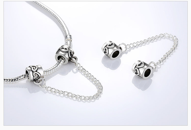 charm bracelet safety chain on a bracelet and also shown separately