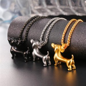 a row of 3 sausage dog pendants in black, silver and gold