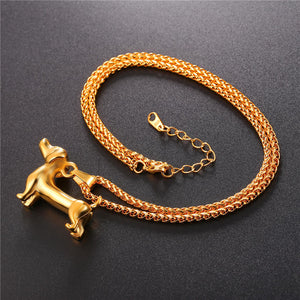 gold sausage dog pendant with chain curled up