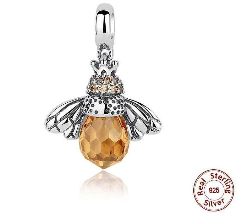 Bee charm with orange glass body and silver wings