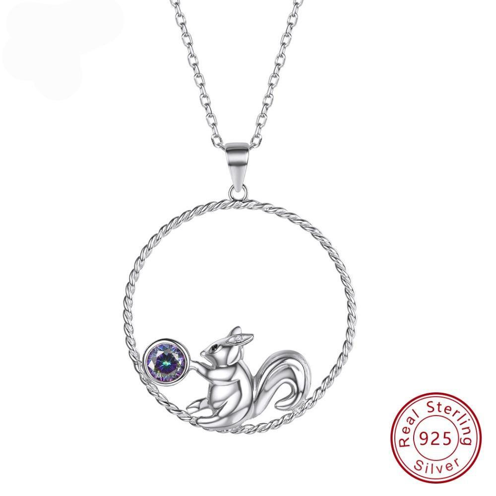 silver circle with squirrel inside holding a gem
