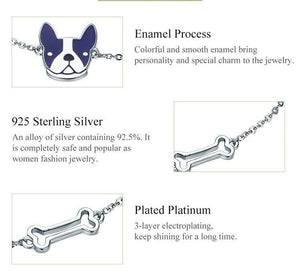 picture showing close up of the dog charm and bone charm on bracelet and words describing the manufacturing process