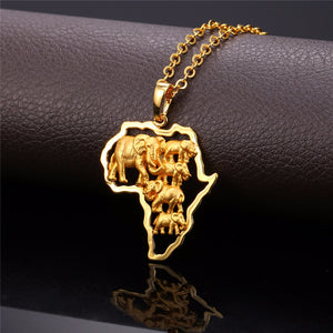 Gold pendant with a herd of elephants inside an outline of Africa
