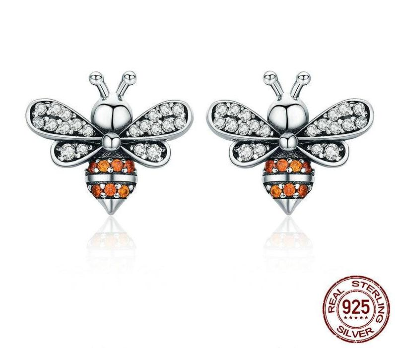 925 Sterling Silver stud earrings Inlaid with cubic zirconia for that extra sparkle