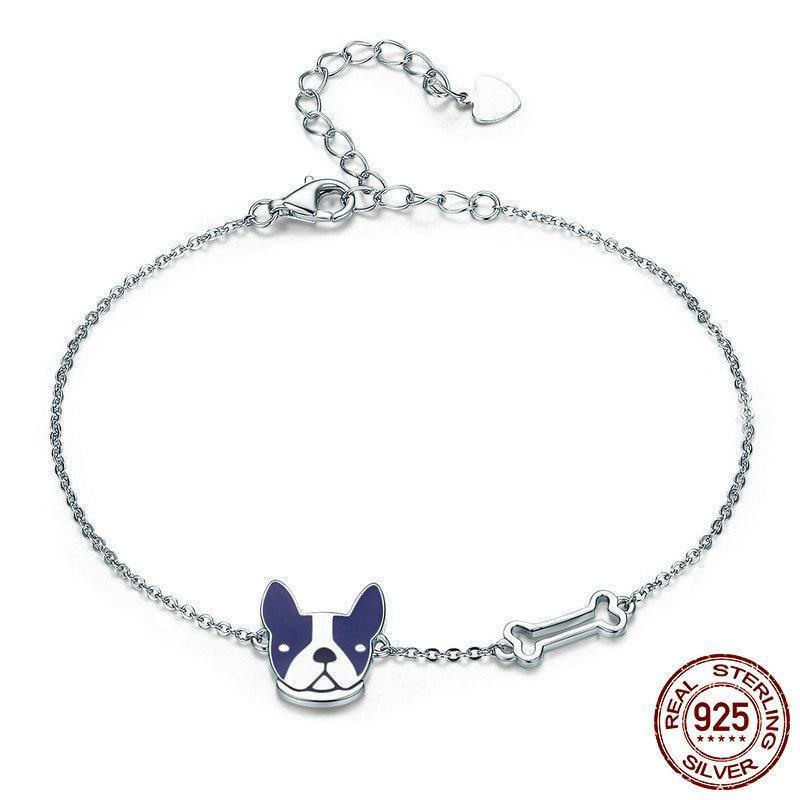 silver bracelet with a french bulldog head finished in blue enamel and a silver bone
