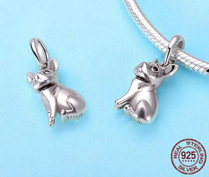 side view of silver bulldog charm alone and on a bracelet