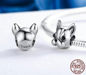 back of french bull dog head bracelet charm sitting next to a bracelet with the charm facing forward