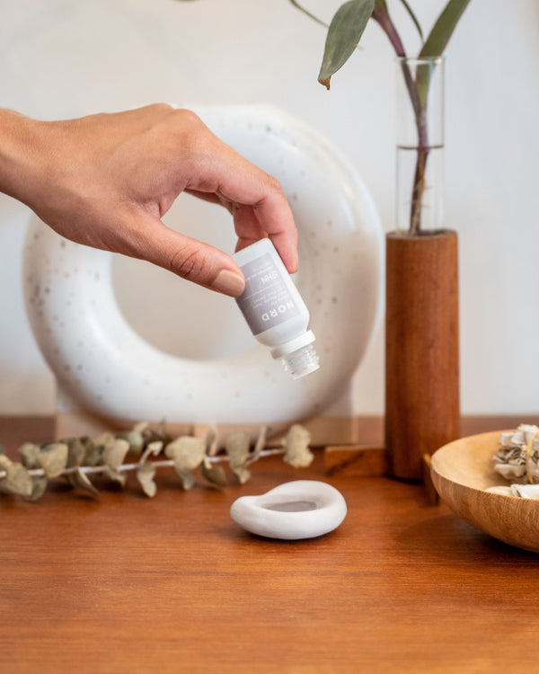 Lohn natural essential oil nord being dropped into ceramic dish