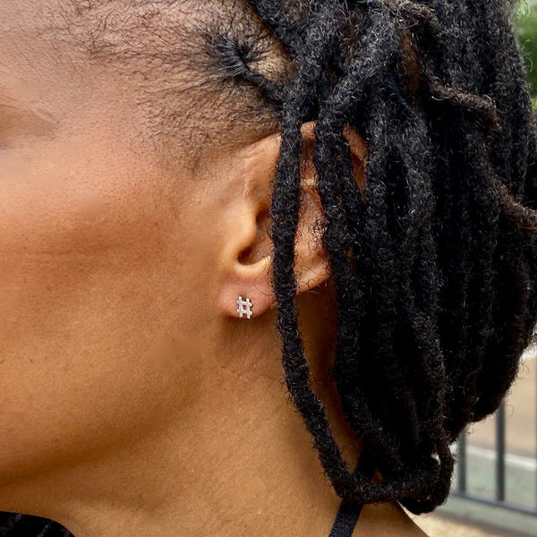 sterlnig silver hashtag earring shown on a woman's ear.
