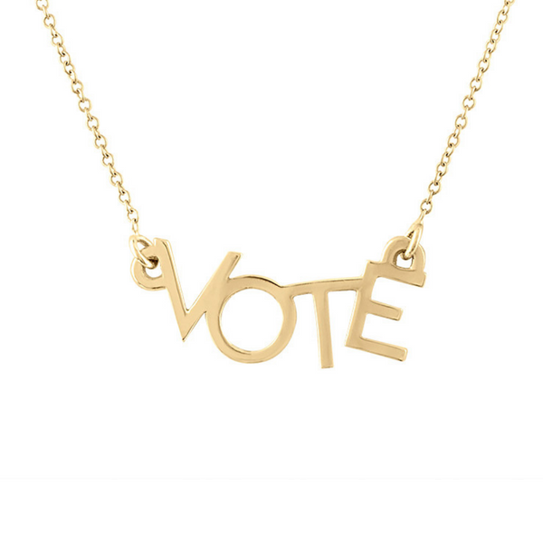 Close up shot of 14k gold VOTE necklace