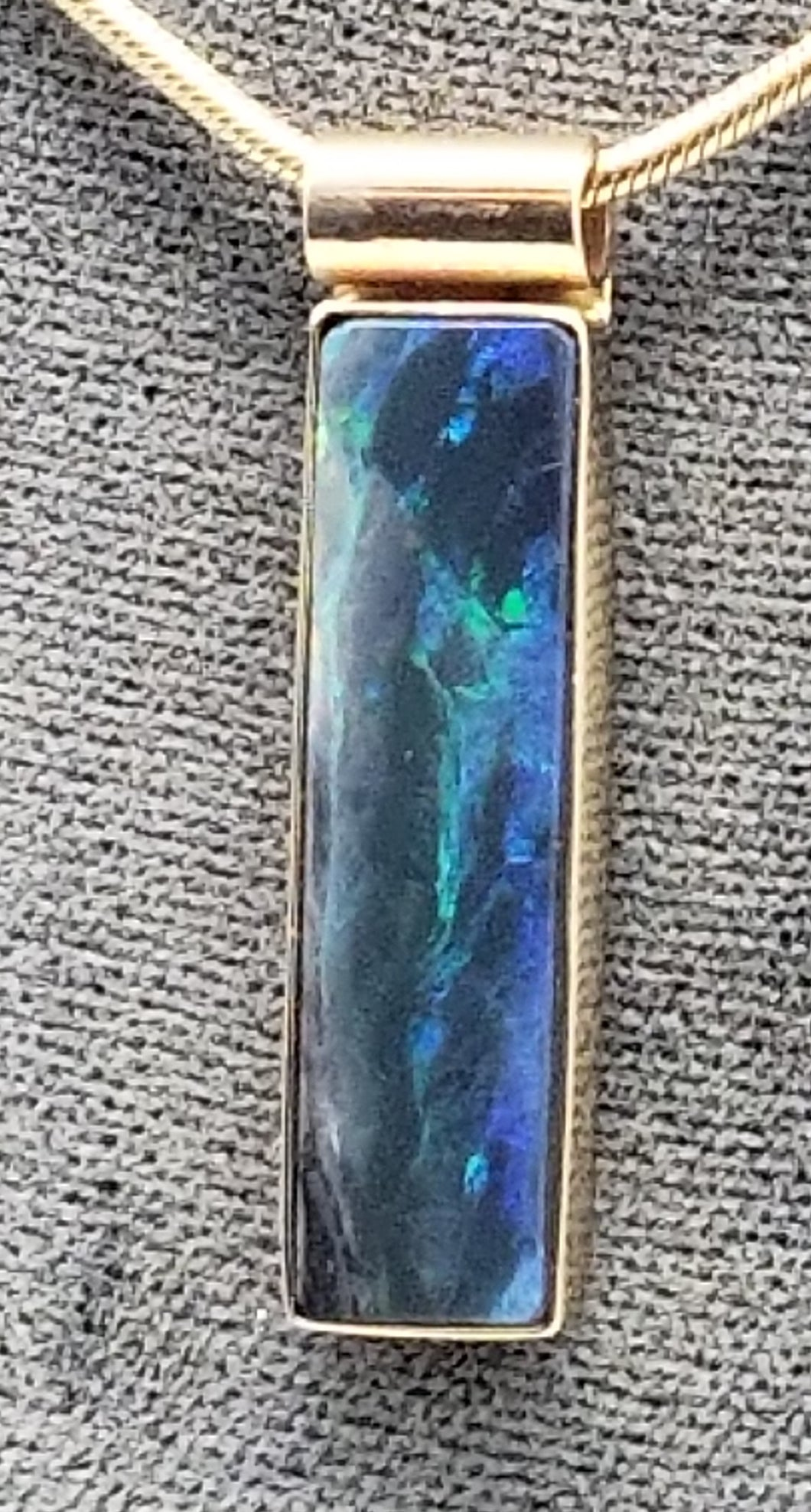 Black Opal Pendant, 14K yellow gold