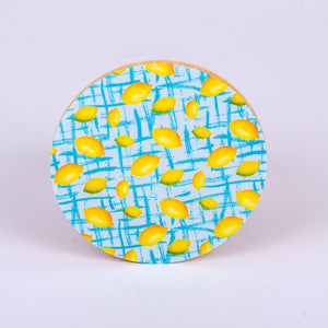 "4"" round rubber coaster with lemons (blue background)"