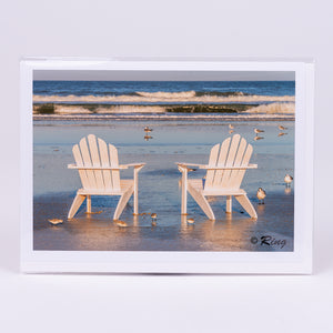 Two adironack chairs photographic notecard on the beach
