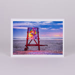 Notecard with Image of Life Guard Stand with Christmas Wreath Lighted on the Beach