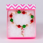 Red, Green and White Bead Bracelet with Flamingo with Santa Hat Charm