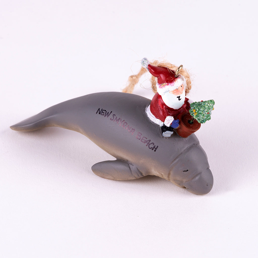 Resin Christmas Ornament (Manatee with Santa) Name Drop:  New Smyrna Beach