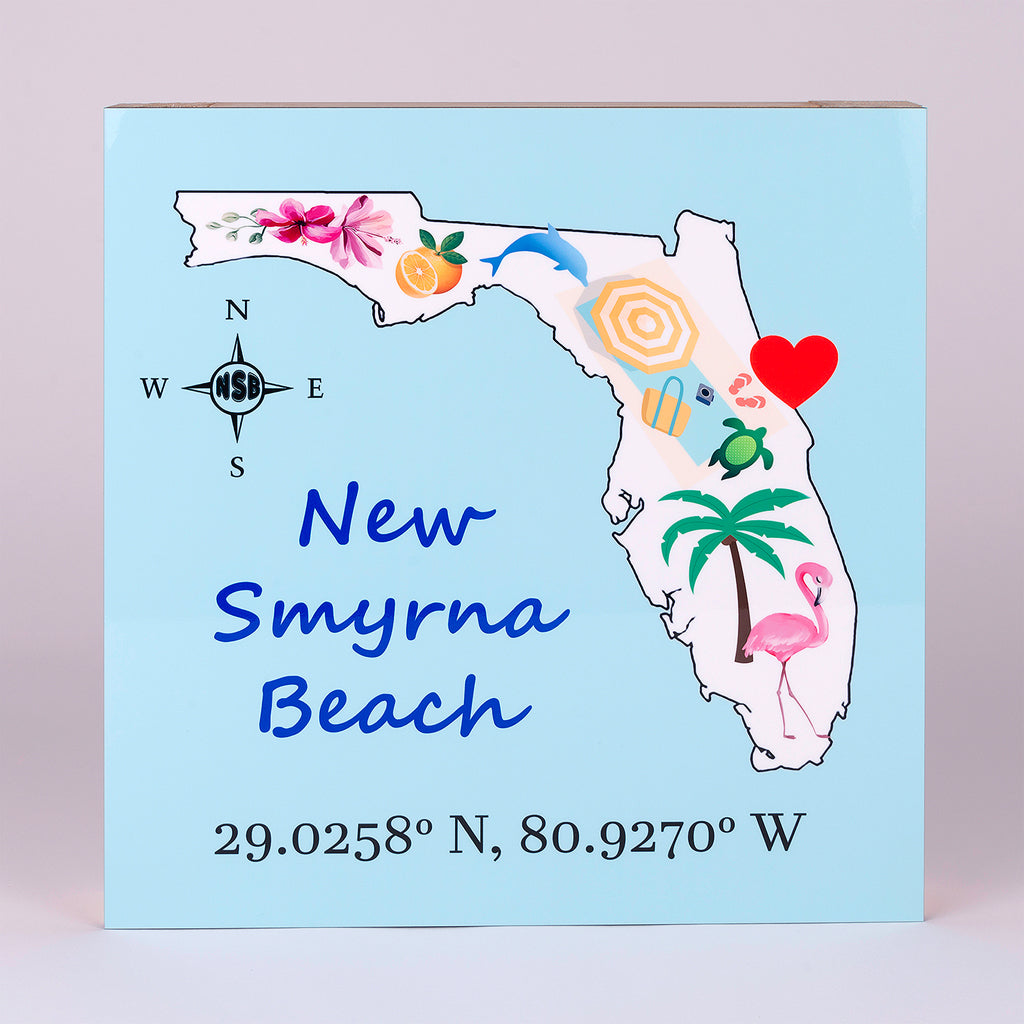 State of Florida Sign in Aqua and characters in the state with heart located at New Smyrna Beach