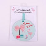 "3.5"" Aluminum Ornament with Santa Flamingo and words ""Warm Wishes"""