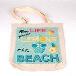 A polyester linen tote bag with words When life gives you lemons go to the beach