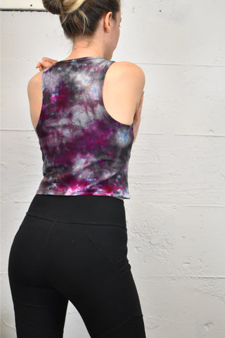 This is a tie dye tank shirt reminiscent of  galaxy artwork. Predominant colors are grey and fuchsia with tints of blue
