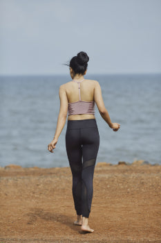 Girl wearing Bodilingo's Mesh Yoga Pants facing her back to camera in South Mumbai