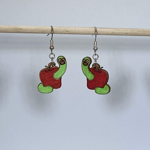 Apple with Happy Worm Dangle Earrings on white background