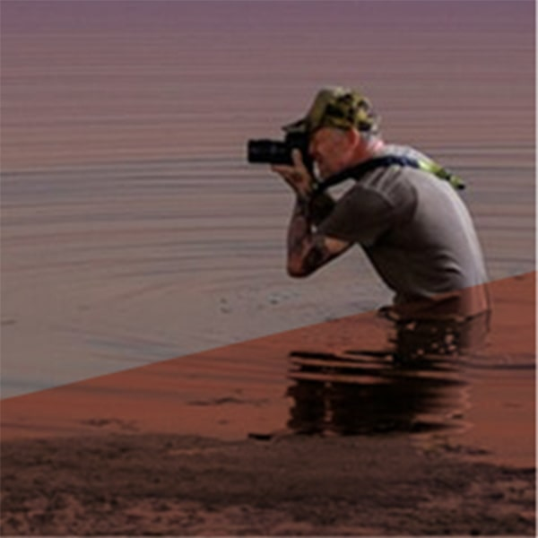 Sean wading out into the water to get the perfect angle on his next shot