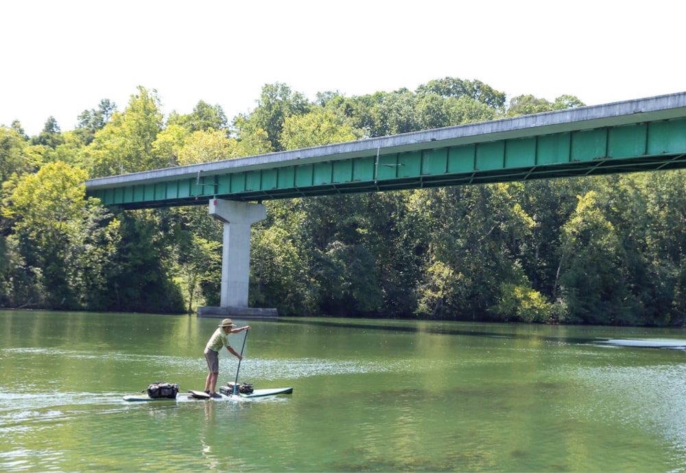 Paddling under a bridge down the Tennessee river
