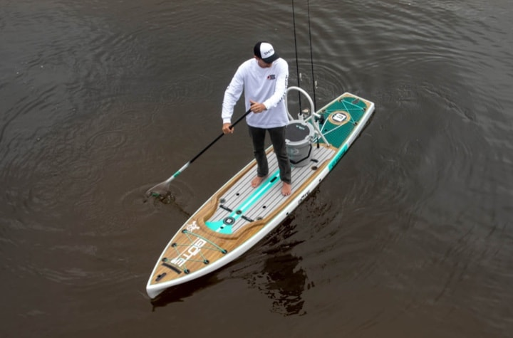 Tall Man on 14' Rackham Gatorshell Classic Paddle Board Fishing