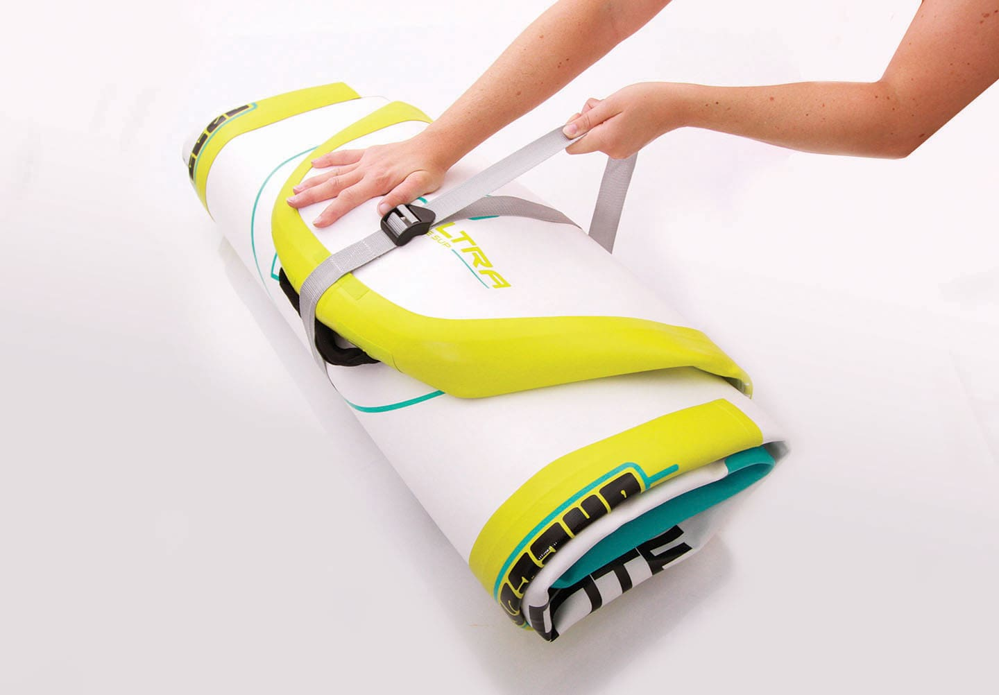 Once fully rolled up, use the compression strap to neatly store the SUP back in the carry bag.
